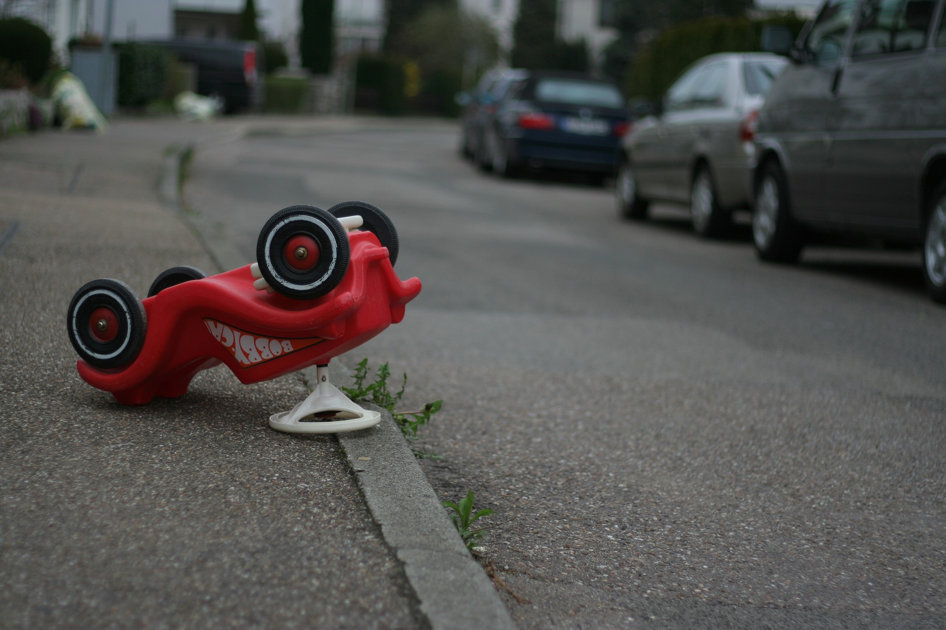 toy car upside down in road