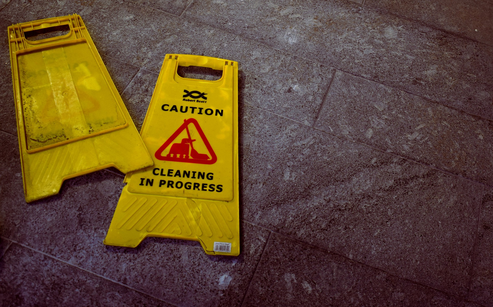 wet floor sign knocked over