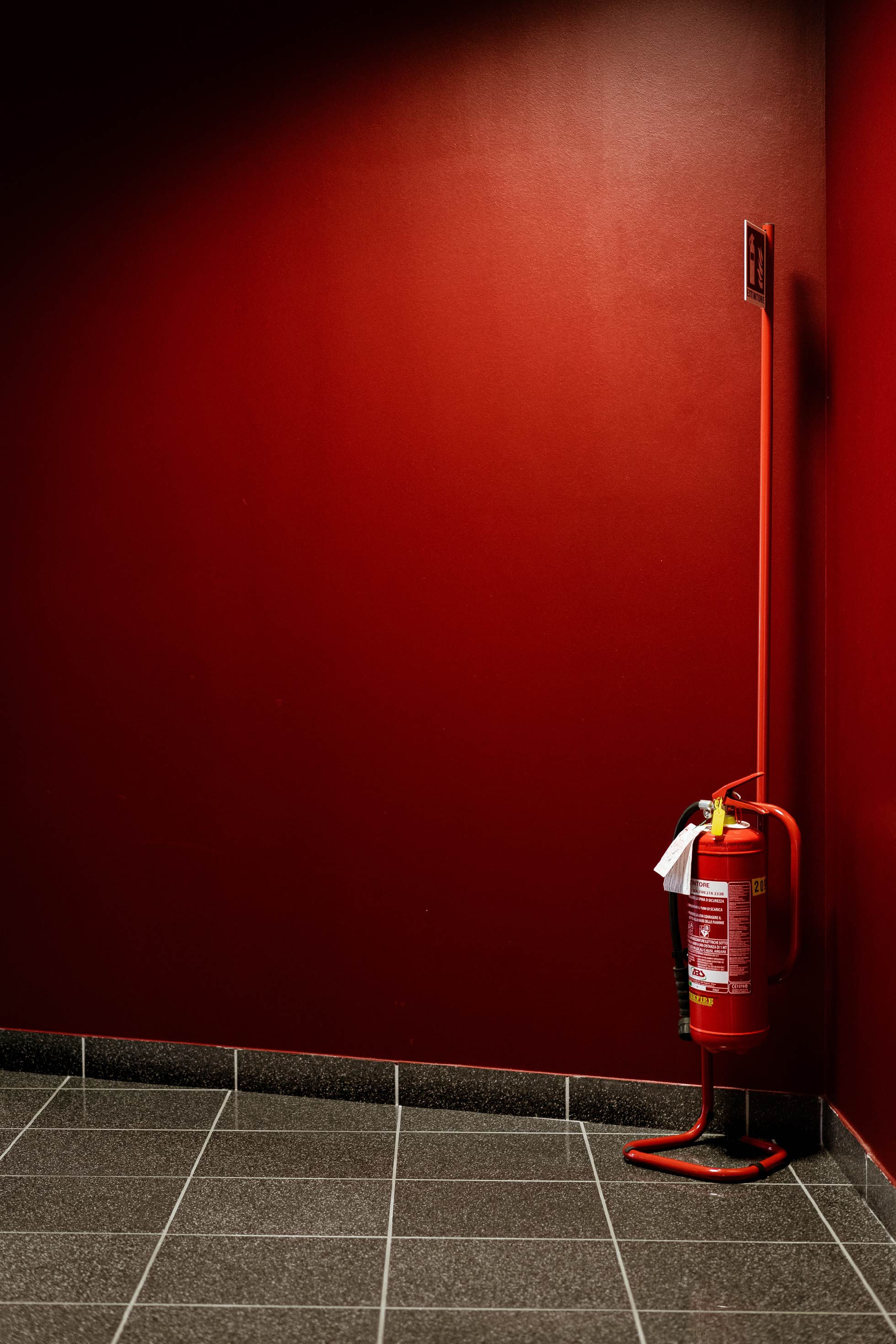 red fire hydrant next to wall