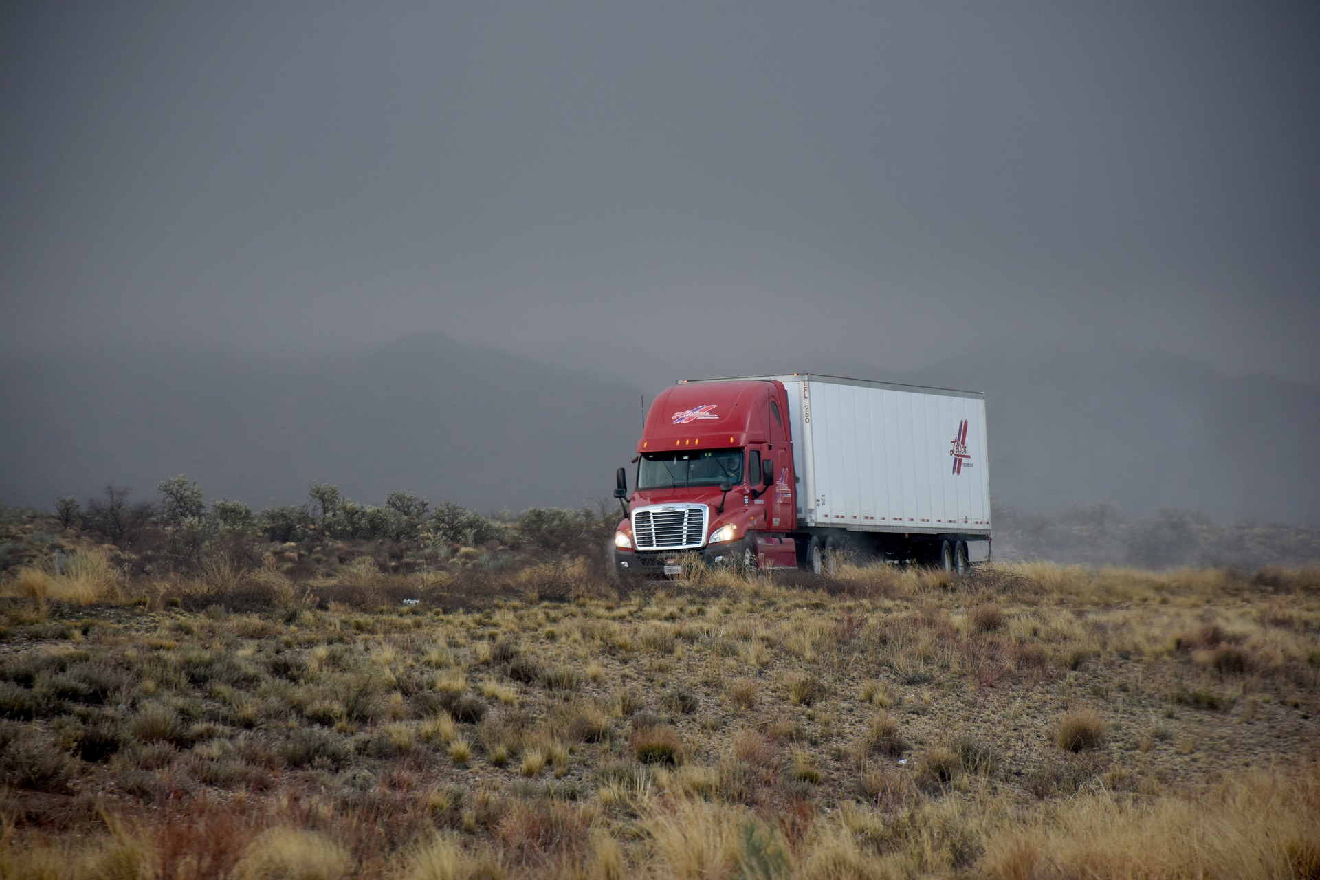 semi truck on the road in the desert